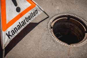 Kanalarbeiter / Helferbild